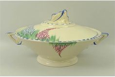 A Burleigh Ware Art Deco part tea set, Rd 766416, in cream ground with blue border and floral and