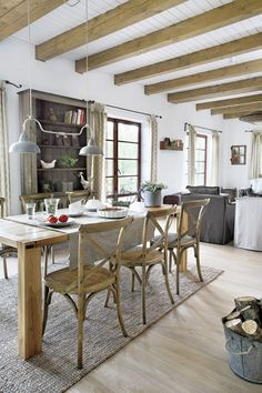 via the art of living. open floor plan, dining through living. natural neutral tone.