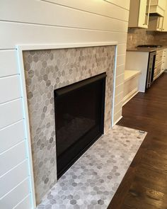 LOVE this hex mosaic tile fireplace surround - Chenille White Hexagon Mosaic by Daltile  |  Light gray stone hexagon tile   |  Fireplace Ideas with White Shiplap