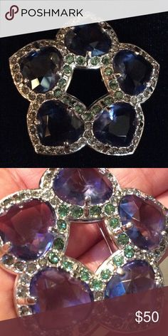 Swarovski crystal pendant Swarovski crystal pendant with indigo and light green with a Rhodium finish. Swarovski Jewelry Brooches
