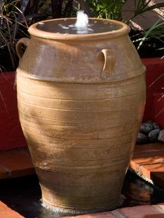 A tall terra-cotta pot is lined and used as a bubble fountain, perfect for a terrace feature. Water circulates from a reservoir concealed below.