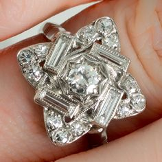 A platinum and diamond Art Deco plaque dress or engagement ring. www.rutherford.com.au