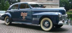"""The 1940 Torpedo had larger windows and wider seats than other Pontiacs, front and rear """"ventiplanes"""" on 4-door sedans and long gracefully streamlined rear decks. Concealed hinges were used on all doors. The doors were extra wide. The hood ornament had a plastic Indian head mounted in a metal base. Front end sheet metal looked like that on other Pontiacs. Eight-cylinder badges were used front and rear. The door locks had weather sealed keyholes."""