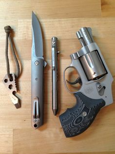 Atwood multi, Boker (Burnley designed) Kwaiken Titanium folder, Fellhoelter TiBolt pen, and S&W .38spl +p with custom grips - a  simple and lightweight EDC that looks both bombproof and beautiful...