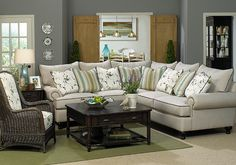 Paula Deen Home over-sized sectional with loose cushion backs, rolled arms and turned legs. Down-blend cushions to sink into. Available in matching sofa, love seat, chair and ottoman.