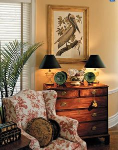 Red and white floral wing chair, chest and framed print. Photo Van Chaplin, http://www.myhomeideas.com