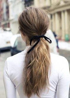 The Girly Ponytail - Ponytails look best when you play up the texture and add a feminine detail. Work a texturizing spray from roots to ends, secure low and loose, and tie a velvet bow around the base for added flair.