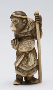 Monkey dressed in the costume of a Japanese noble.