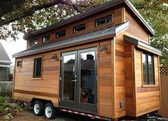 Tiny Homes l Energy Efficiency - side french doors, full kitchen, small bathroom next to kitchen leaving one end to be open.