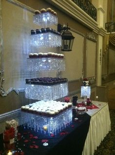 (bet this could be a DIY look-a-like project by using clear glass cake stands or acrylic sheets with LED or icicle Xmas lights...hum-m-m / B.) -- Tiers of Joy - Custom Crystal Creations -USA - www.cakeappreciationsociety.com