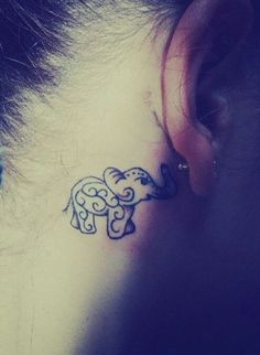 Elephant tattoo behind the ear