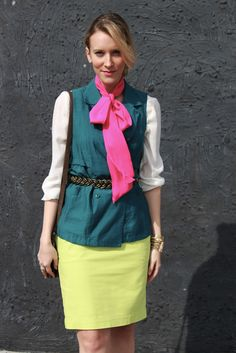 Colorblock, neon yellow pencil skirt, pink bow tie, teal vest, white blouse, braided metal belt