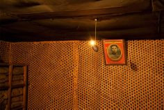 A photograph of Kim Il Sung hangs on a wall next to a light made from a grenade inside an exhibit, made to look like underground bunkers used during the resistance against the Japanese occupation, at the war museum in Pyongyang, North Korea, on March 9, 2011. (AP Photo/David Guttenfelder)