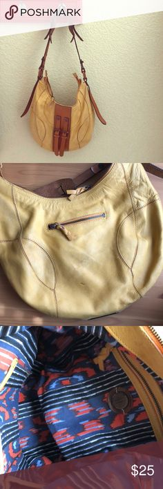Yellow Holding Horses bag from Anthropologie. Yellow leather, textile interior. Zippered closure, one exterior zippered pocket, two small interior side pockets and one large interior zippered pocket. Just the right size to carry everything you need! Slight wear on the back. Anthropologie Bags Shoulder Bags