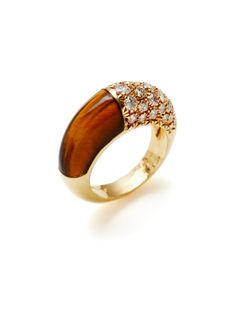 Cartier 18K yellow gold and tiger's eye cabochon band ring with round cut diamond details