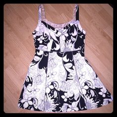 "NWT Trina Turk sun dress This beautiful sun dress is black and white with a flower print design. Fully lined. 34.5"" from shoulder to hem. 16"" waist 19"" bust 20"" hips. Trina Turk Dresses Midi"