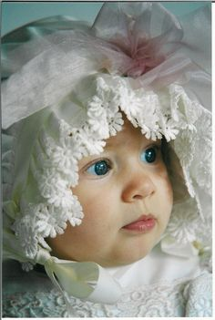 baby in vintage bonnet and dress
