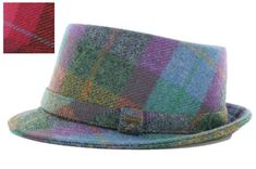 "This women's Irish hat will certainly add panache to your daily wear! This fedora style hat features a wide brim all around the outside with a gorgeous plaid design. The hat measures approximately 22 7/8"" in circumference and is crafted from 100% wool. This Irish hat is made by Mucros Weavers located in Killarney, Co. Kerry Ireland."