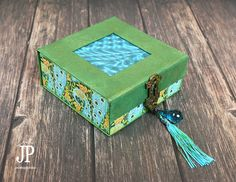 Graphic45---Clearsnap-Peacock-Mens-Trinket-Box-with-Tassel-JPriest Today I am on a blog hop with Clearsnap and Graphic 45! Check out this fab box I made for my husband using G45's Artisan Style line and ColorBox Ink. Head on over to see my tutorial and to enter to win a set of ColorBox Graphic 45 Decades Antiquing Dye Ink Pads. #ad