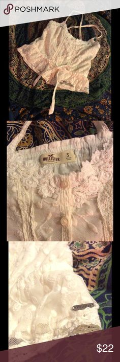 Hollister Lacey Summer Top Super cute and summery, light weight, buttons down the front, and ties at the waist for a peplum look. Would look great with high-waisted shorts! Perfect for the festival look! Hollister Tops Crop Tops
