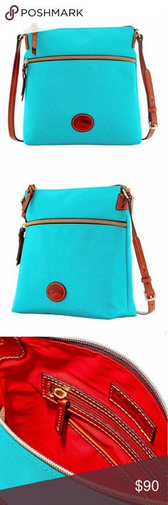 """Just In***Dooney & Bourke Crossbody Aqua DB crossbody. Large front zip pocket. Adjustable leather strap with 22"""" drop length. Interior includes one zip pocket, 2 slide pockets, cell phone pocket and key hook.  10"""" x 10-1/2"""" x 4"""" Dooney & Bourke Bags Crossbody Bags"""