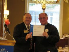 District Governor Tom Schmidt presenting Dave Thomas and the Rotary Club of Petoskey - 2811 an award for all of our support towards ending polio.