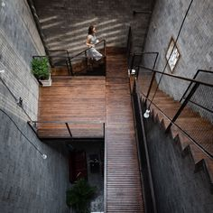 Zen House by HA - The 78-square-metre building is planned around a central atrium, located beneath a glass ceiling flanked by wooden louvres.This allows light to reach rooms on all four floors, even though there are very few external windows.