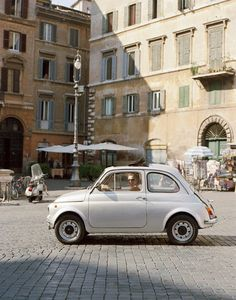 We would travel to italy and motor about town in this spot of a car, that I utterly adore!