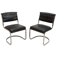 Set of Four Ribbed Black Leather and Chrome Cantilever Dining Chairs | From a unique collection of antique and modern dining room chairs at https://www.1stdibs.com/furniture/seating/dining-room-chairs/