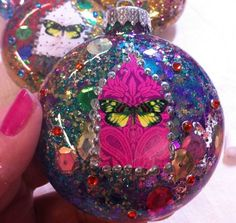 This one reminds me of that really gaudy Mary nightlight. This could be done more cute though... maybe with Peacocks? Sparkle Collage Ornaments | Community Post: 39 Ways To Decorate A Glass Ornament