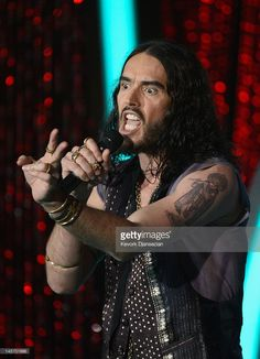 Host Russell Brand speaks onstage during the 2012 MTV Movie Awards at Gibson Amphitheatre on June 3, 2012 in Universal City, California.