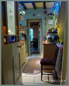 Looking through the cottage kitchen to the dinning room