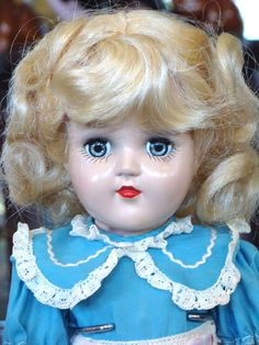 Pretty 14 inch hard plastic Toni doll by Ideal with her original box and wave set.  She has platinum blond hair (some photos it looks yellow), blue