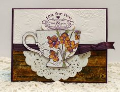 "Stampin Up Tea Shoppe set . Embossed the cup on Blackberry Bliss with white powder and colored flowers with markers. Hardwood stamp for ""table"", Whisper White with Lovely Lace embossing folder for wallpaper, Blackberry Bliss ink, ribbon, and cardstock.     Sleepy in Seattle"