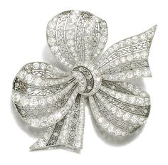 DIAMOND BROOCH, HENNELL, CIRCA 1913.  Designed as a lace ribbon tied into a bow, set with circular-, single-cut and rose diamonds, signed Hennell.