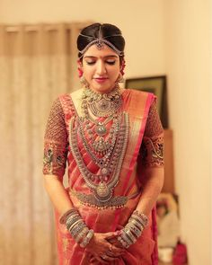 Real Brides who donned the most Scintillating Silk Sarees - This bride took her fashion game a notch above by wearing an exquisite coral silk saree with layere - South Indian Bride Saree, Kerala Bride, Indian Bridal Sarees, Bridal Silk Saree, Hindu Bride, Indian Bridal Fashion, Indian Wedding Outfits, Saree Wedding, Silk Sarees