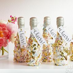 Confetti Champagne Bottles - you can't throw a New Year's Eve party without a fun party favor like these mini champagne bottles covered in confetti, and they are easy to make! Diy New Years Party Favors, New Years Eve Party, Mini Champagne Bottles, Champagne Party, Birthday Party Decorations, Party Themes, Ideas Party, Event Ideas, Wedding Decorations