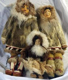 Alaskan Dolls made of Fur with wooden carved Face and Body.