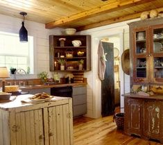 A New Angle: Install an antique corner cabinet in the kitchen to get a great angle on primitive style. Replace interior doors with salvaged or rough-hewn examples that uphold your home\