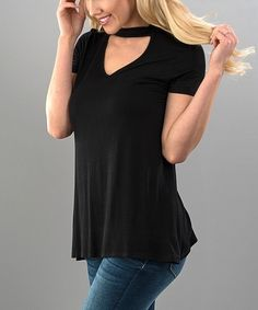 We are loving this choker neck triangle cut out short sleeve top.  This top look fabulous day and night!