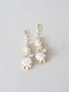 Adorned with crystals and pearl beads, ivory flower petal pendants on a gold plated base. Wedding Earrings, Wedding Jewelry, Design Shop, Clip On Earrings, Stud Earrings, Ivory Pearl, Pendant Design, Swarovski Pearls, Fashion Earrings
