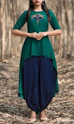 Beautiful Cotton-Mul Tail cut kurti with dhoti style pant. Salwar Designs, Kurti Neck Designs, Kurta Designs Women, Kurti Designs Party Wear, Simple Kurti Designs, Patiala Suit Designs, Indian Fashion Dresses, Dress Indian Style, Indian Designer Outfits