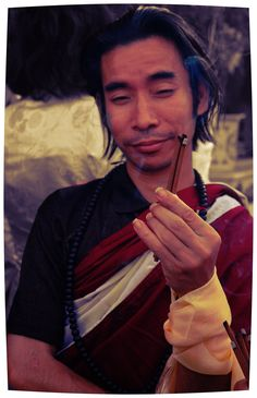 https://flic.kr/p/MR4ge3 | Buddhist with inscrutable attitude holding incense offering on Bodhisattva Day, Sakya Lamdre Hevajra empowerment Tharlam Monastery Boudha Kathmandu Nepal