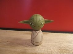 I am not a star wars fan...but this is adorable. yoda kokeshi