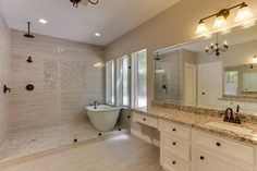 7707 Oxfordshire Dr Spring, TX 77379: Photo First of two vanity areas