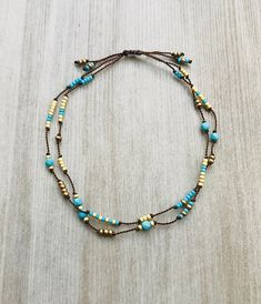 Subtle boho chic. I have hand knotted a variety of tiny turquoise, glass and gold pated seed beads onto chocolate brown silk cord. This is a wonderful stand alone or layering bracelet. The bracelet is finished with a knotted slide fitting wrists between 6 - 7 1/2. If you need a special