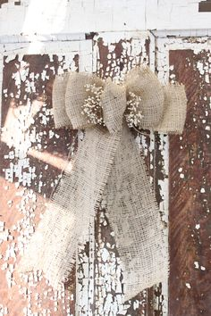 Love this ... would like to incorporate lace too  Burlap wedding/rustic/fall/christmas bow. $7.00, via Etsy.