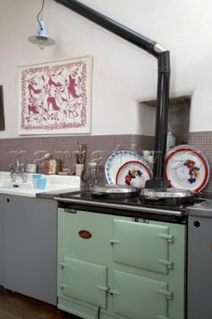 Range oven with chimney flue in kitchen Cornwall UK