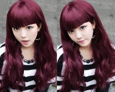 Asian with long red wine purple plum hair.