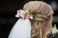 A subtle nod the the popular flower crown for this brides wedding day hair